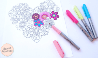 Heart coloring sheet full of detailed flowers so you can color your heart out