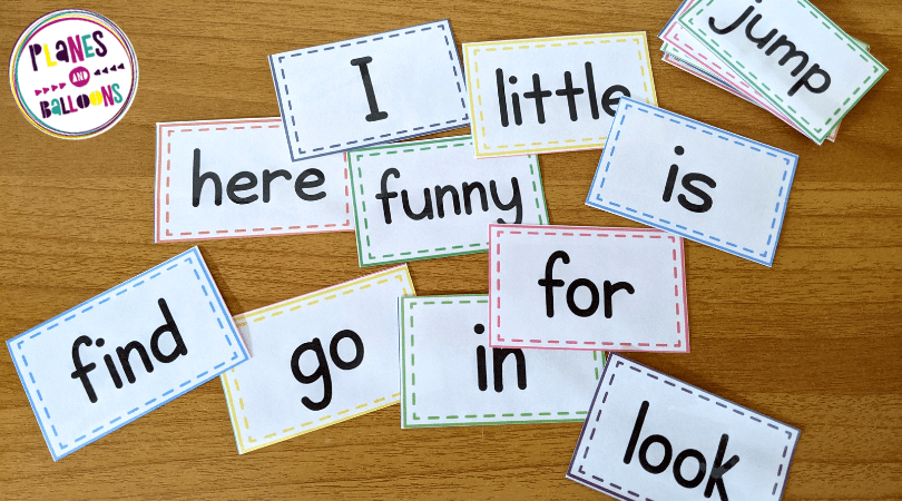 Pre primer sight words flash cards on a wooden tabletop